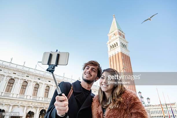 Couple taking selfie in Piazza San Marco Venice