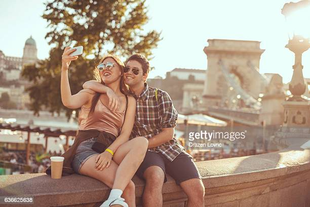 couple taking selfie near famous landmark - budapest stock pictures, royalty-free photos & images