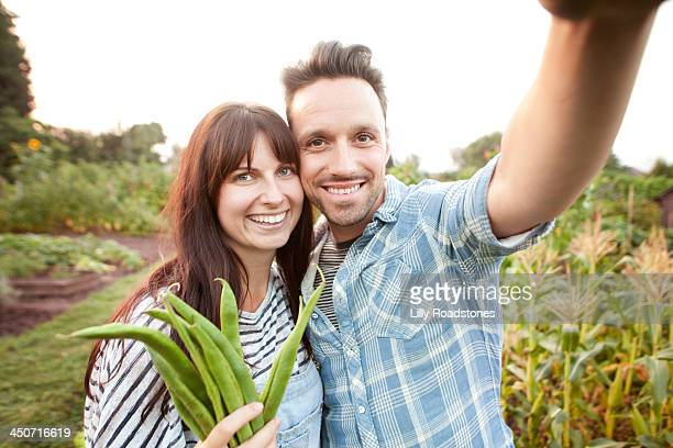 Couple taking selfie on allotment