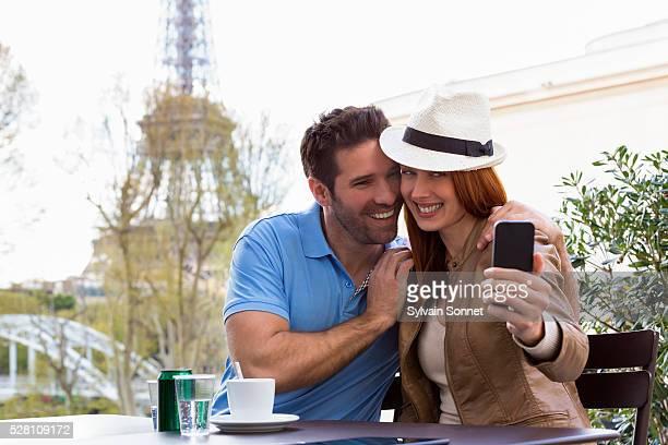 Couple taking selfie photo, Paris, France