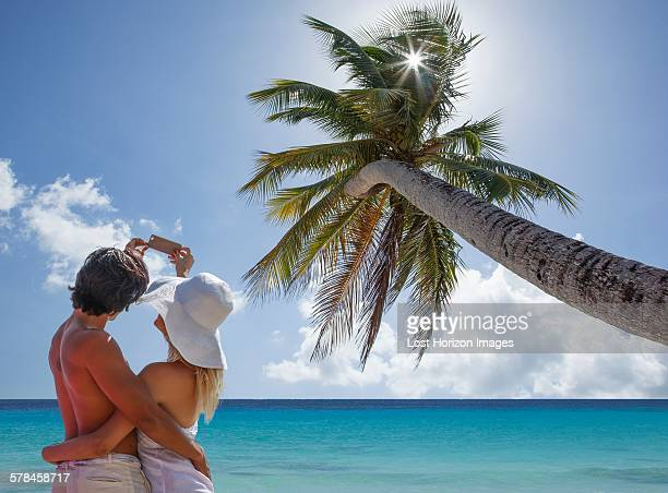 Couple taking selfie with smartphone on beach