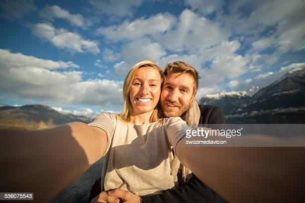 Couple taking selfie-Hug