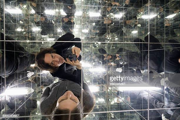 Couple taking selfies in a house of mirrors