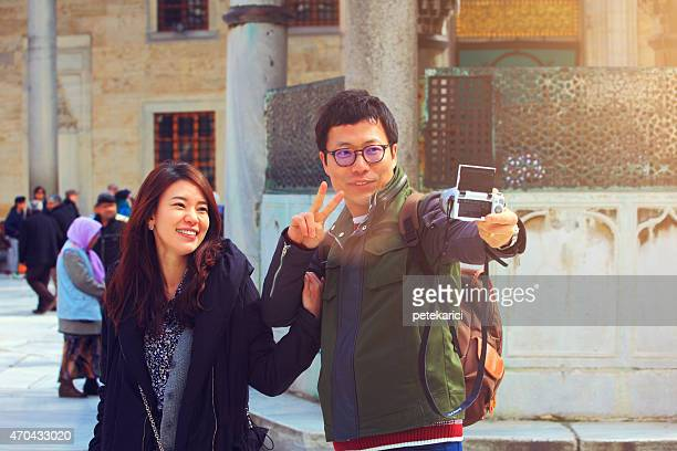 Couple taking selfies in front of Blue Mosque in Istanbul