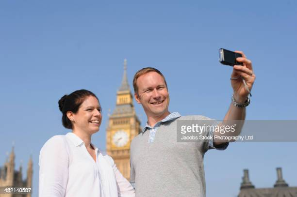 couple taking self-portrait outside big ben, london, united kingdom - travelstock44 stock pictures, royalty-free photos & images
