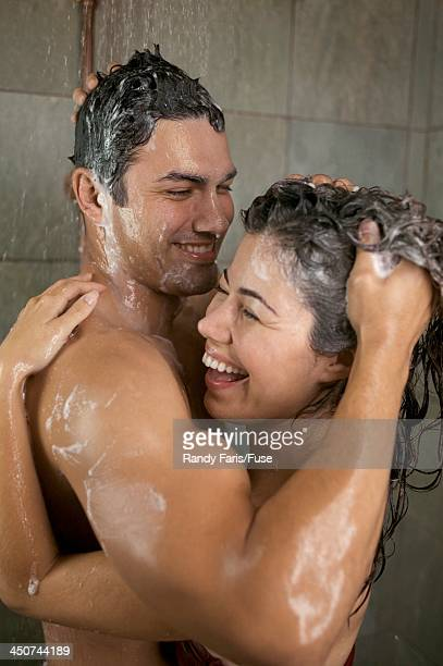 couple taking shower together - couples showering stock pictures, royalty-free photos & images