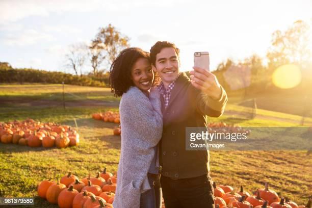 couple taking while standing in farm - nur erwachsene stock-fotos und bilder