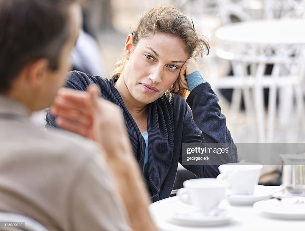 Couple Talking at a Cafe : Stock Photo