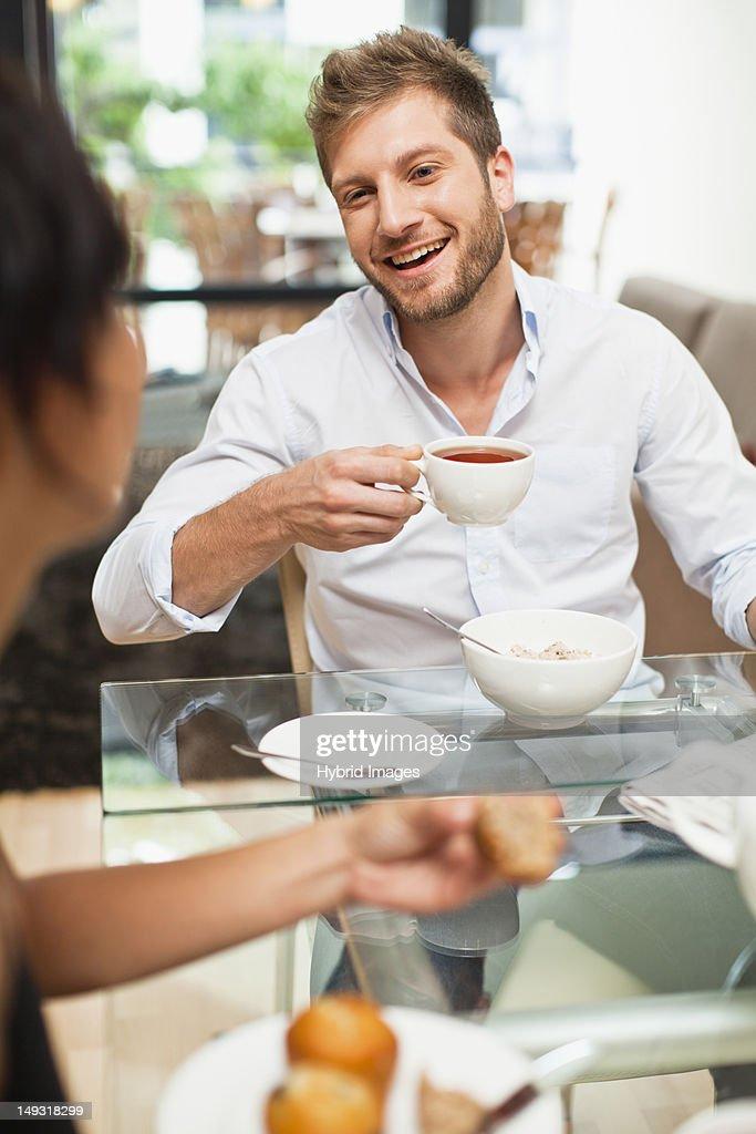 Couple talking at breakfast : Stock Photo