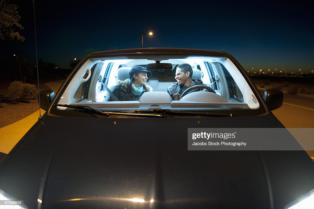 Couple Talking In Car At Night High Res Stock Photo Getty Images