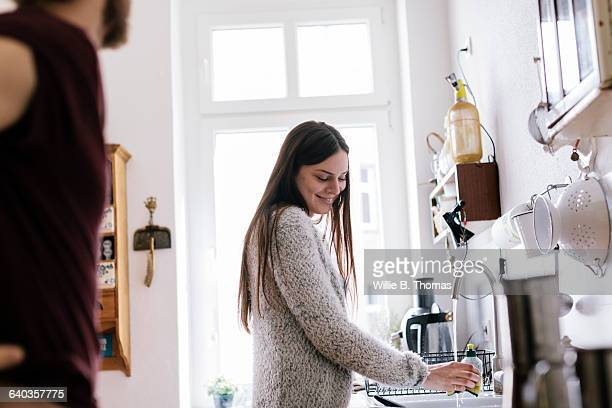 couple talking in kitchen - day in the life stock photos and pictures
