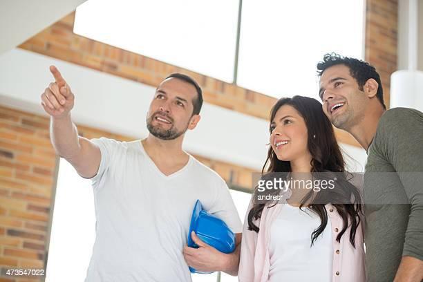 Couple talking to a repair man