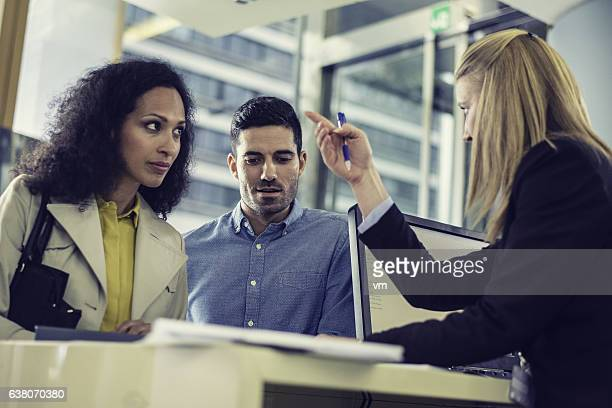 Couple talking to bank employee about loan