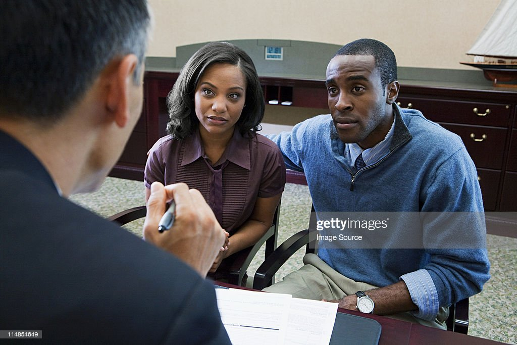 Couple talking to bank manager : Stock Photo