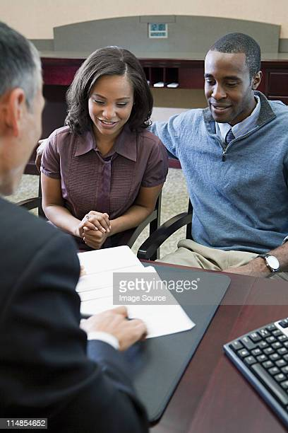 Couple talking to bank manager