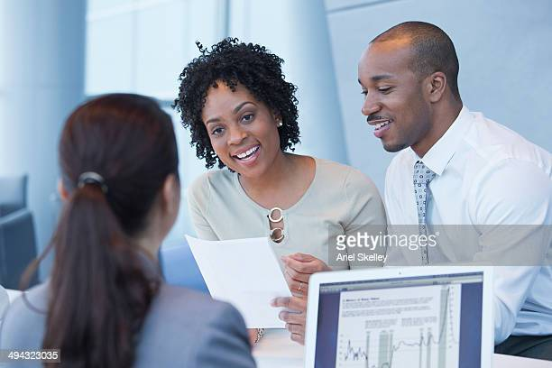 couple talking to loan officer - bank manager stock pictures, royalty-free photos & images