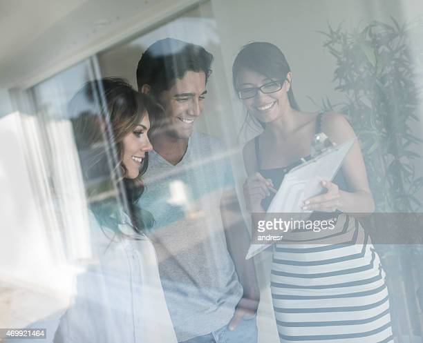 Couple talking to real estate agent about buying a house