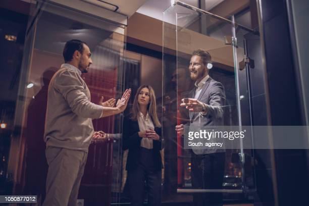Couple talking to salesman