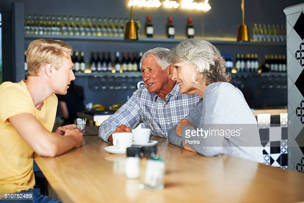 Couple talking to son at cafe