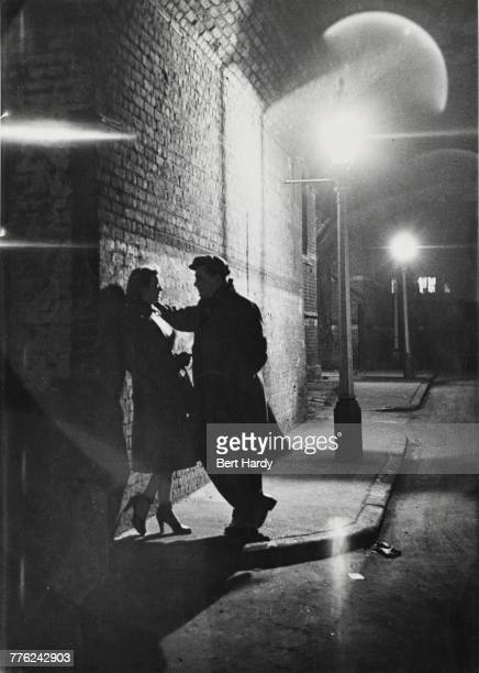 A couple talking under a railway arch in the Elephant and Castle district of south London January 1949 Original Publication Picture Post 4694 Life In...
