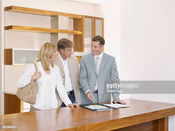 Couple talking with interior designer
