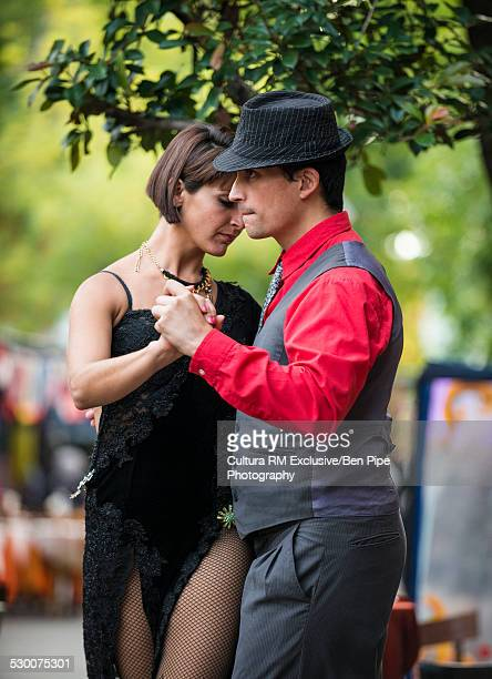 couple tango dancing on street, el caminito, la boca, buenos aires, argentina - argentina traditional clothing stock photos and pictures