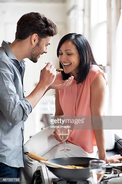 Couple tasting food