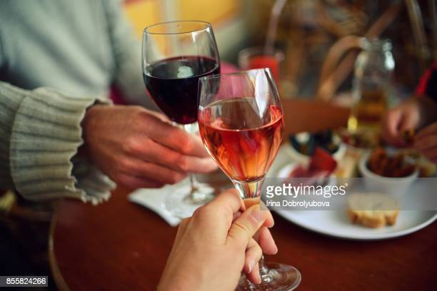 couple tasting rose and red wine from personal perspective