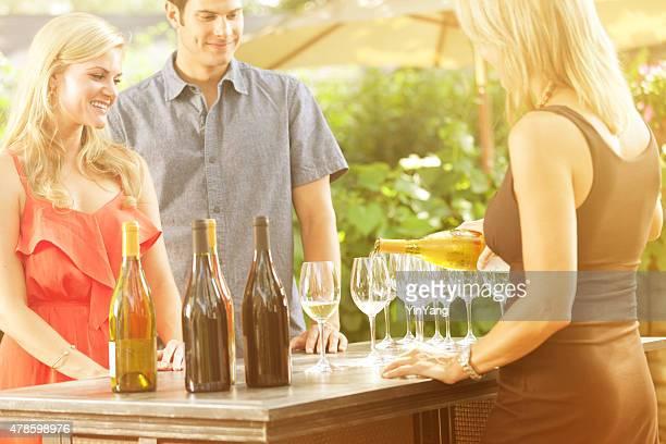 Couple Tasting Wine at Winery Vineyard Winetasting in Wine Country