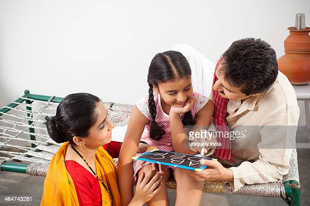 Couple teaching their daughter