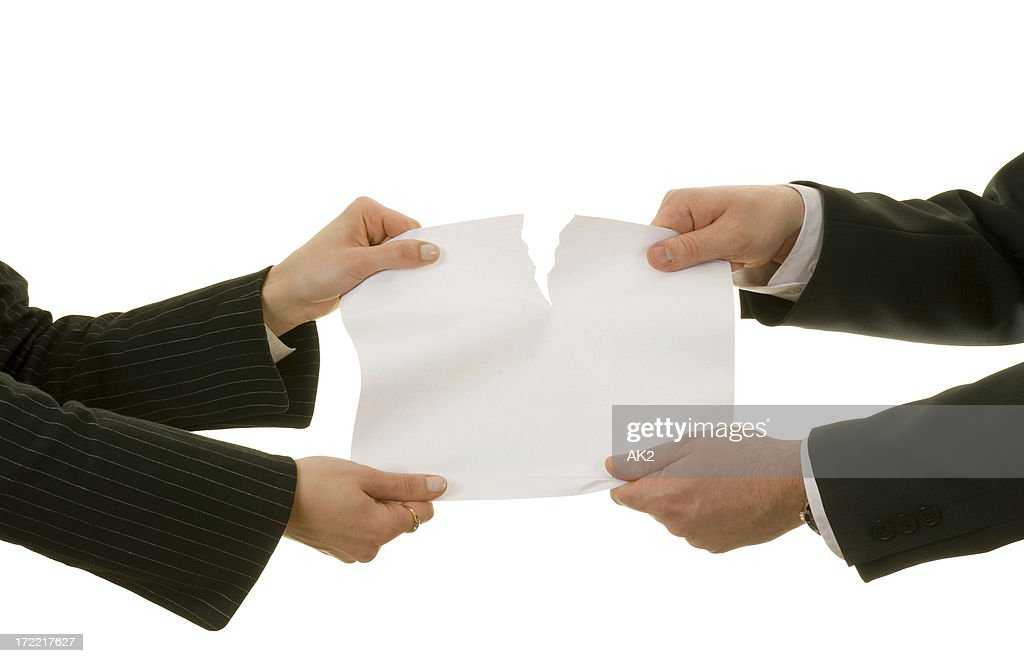 Couple tearing a paper : Stock Photo