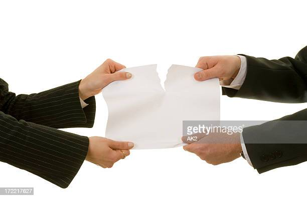 Couple tearing a paper