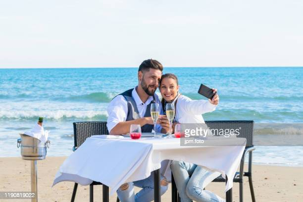 couple sharing romantic dinner beach they