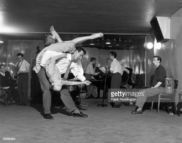 A couple throw themselves into an energetic jive at a studio in London Original Publication Picture Post 8744 Rock 'n' Roll unpub