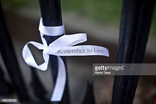 A couple tie 9/11 remembrance ribbon that reads 'Remeber to Love' is toed on the St Paul Church fence in Lower Manhattan on Friday September 9 2011