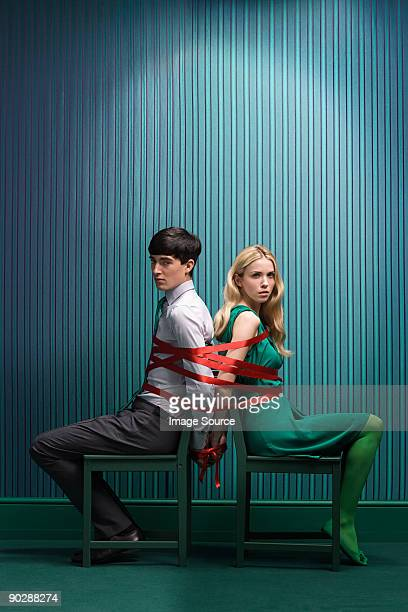 couple tied together - freaky couples stock photos and pictures