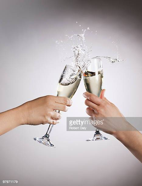 couple toasting champagne flutes and spilling - wine glass stock pictures, royalty-free photos & images