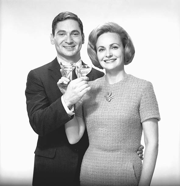 Couple Toasting Champagne In Studio, (B&W),, Portrait Wall Art