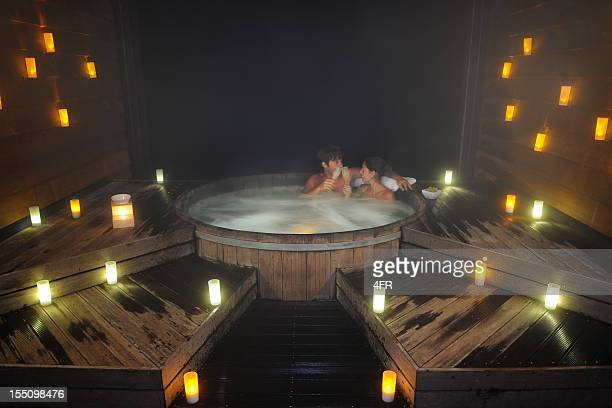 Couple toasting in a hot tub