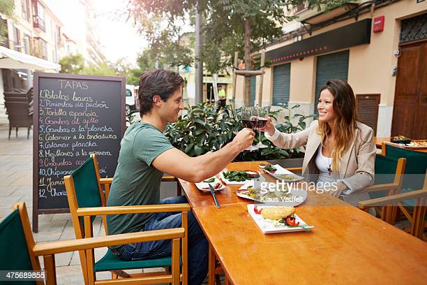 couple toasting in redwine at restaurant - tapas stock photos and pictures