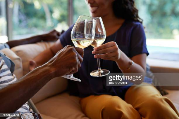 couple toasting in wine - white wine stock pictures, royalty-free photos & images