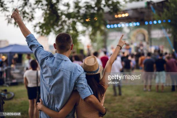 couple toasting on a music festival - music festival stock pictures, royalty-free photos & images