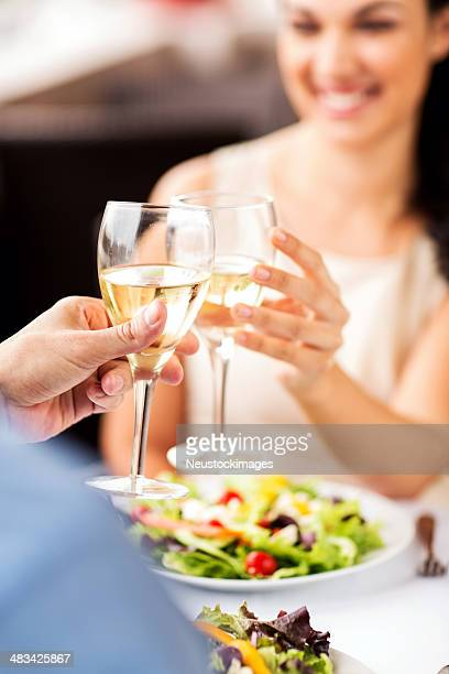 Couple Toasting Wine Glasses At Restaurant