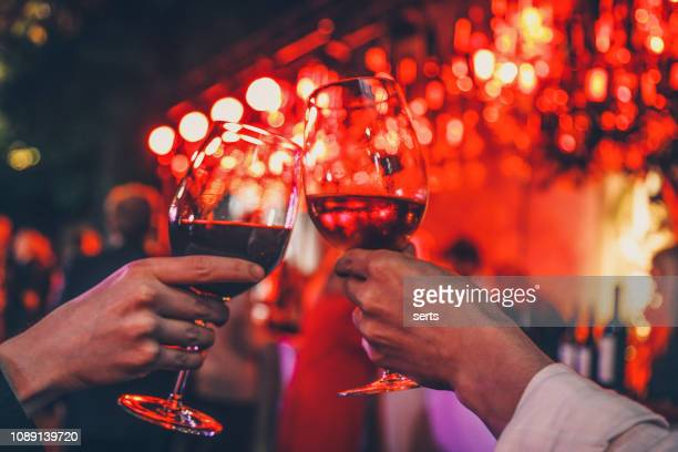couple toasting wine glasses - valentine's day holiday stock pictures, royalty-free photos & images