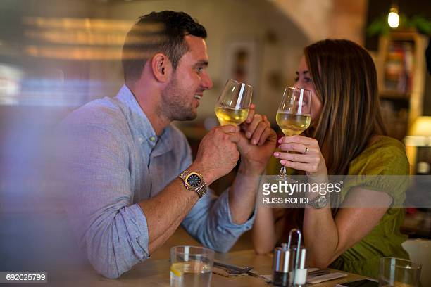 Couple toasting wine in restaurant