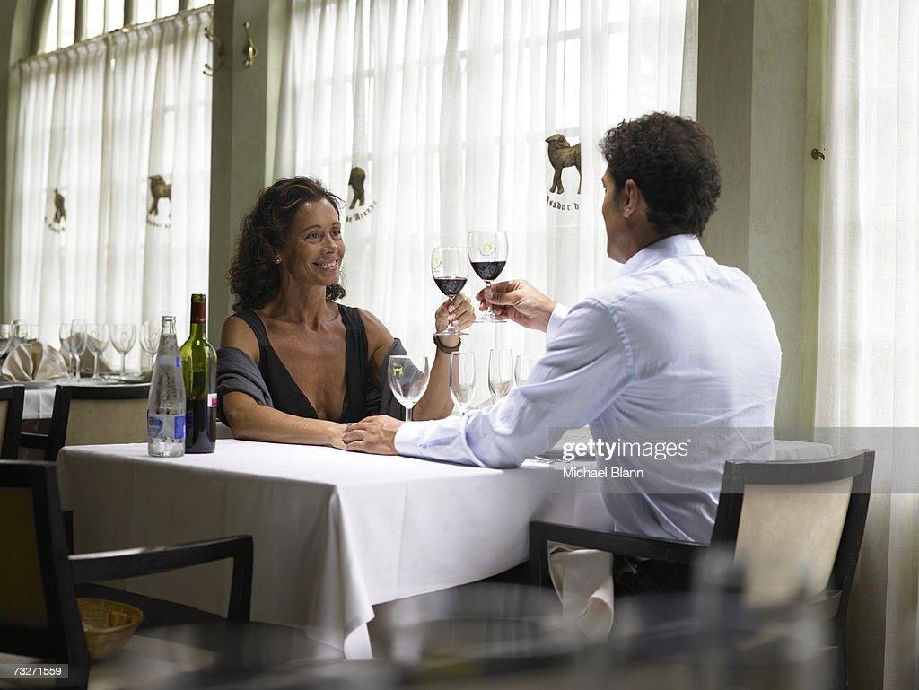 Couple toasting wine in restaurant : Stock Photo