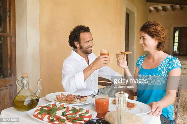 Couple toasting wine on patio