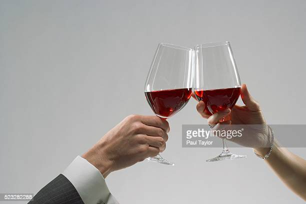 Couple toasting with glasses of red wine
