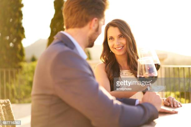 couple toasting with red wine glasses