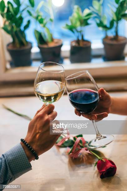 Couple toasting with wine, close-up